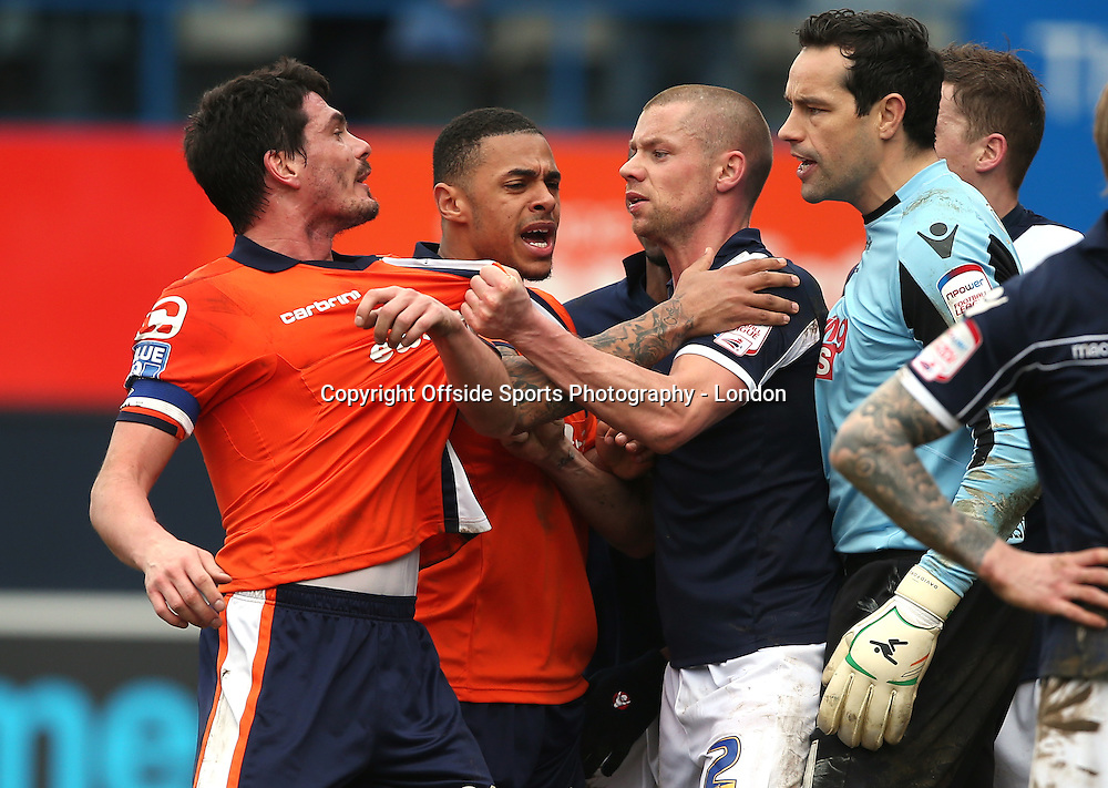 16 February 2013 FA Cup 5th round. Luton Town v Millwall.<br /> Luton captain Ronnie Henry (far left) and Andre Gray get involved in a disagreement with Millwall defender Alan Dunne and goalkeeper David Forde.<br /> Photo: Mark Leech