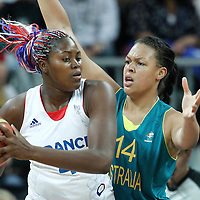 30 July 2012: Isabelle Yacoubou of France looks to pass the ball over Elizabeth Cambage of Australia during the 74-70 Team France overtime victory over Team Australia, during the women's basketball preliminary, at the Basketball Arena, in London, Great Britain.