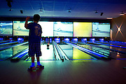 Evan Bernstein (9) watches his ball as he bowls during the 6th annual Zweig Family End of School Year Bash at 300 Dallas in Addison on Sunday, April 14, 2013. (Cooper Neill/The Dallas Morning News)
