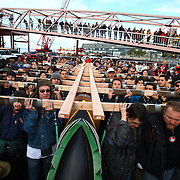 People carry a totem pole estimated to weigh nearly 5,000 pounds during a procession to the Seattle Center from pier 57 on Sunday February 26, 2012 in Seattle. The 33-foot tall totem pole was erected Sunday in honor of slain Native American woodcarver John T. Williams. Williams was shot and killed by a Seattle Police officer in 2010. The shooting was later ruled unjustified.  (Joshua Trujillo, seattlepi.com)