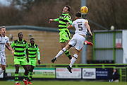 Forest Green Rovers Christian Doidge(9) and Port Vale's Joe Davis(5) challenge for the ball during the EFL Sky Bet League 2 match between Forest Green Rovers and Port Vale at the New Lawn, Forest Green, United Kingdom on 6 January 2018. Photo by Shane Healey.