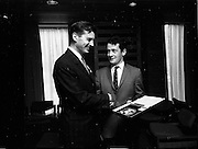 16/07/1970<br /> 07/16/1970<br /> 16 July 1970<br /> Opening of extension to the Four Courts Hotel, Dublin. Picture shows Mr. Peter Dunn (Director) presenting a memento to Mr. Desmond O'Malley T.D. at the opening ceremony.