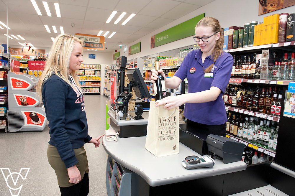 Pictured is Lucy Torn serving a customer using new Lincolnshire Co-operative's bags for life<br /> <br /> Lincolnshire Co-operative food store, Long Bennington, Lincolnshire.<br /> <br /> Date: September 28, 2015