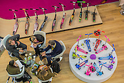A sales meeting on the Authentic |Scooters stand - The London Toy Fair opens at Olympia exhibition centre. Organised by the British Toy and Hobby Association it is the only dedicated toy, game and hobby trade exhibition in the UK. It runs for three days, with more than 240 exhibiting companies ranging from the large internationals to the new start up companies.