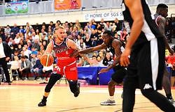Jordan Nicholls of Bristol Flyers tries to get past Tyler Johnson of London Lions- Photo mandatory by-line: Nizaam Jones/JMP - 19/10/2019 - BASKETBALL - SGS Wise Arena - Bristol, England - Bristol Flyers v London Lions - British Basketball League Cup