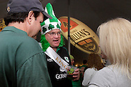 (from left) Mike Gran of Centerville, 'king' Kevin Krumholtz of Washington Township and Hope Caulfield of Kettering during the WTUE St. PatROCKS Party at Flanagan's Pub in Dayton, Saturday, March 17, 2012.