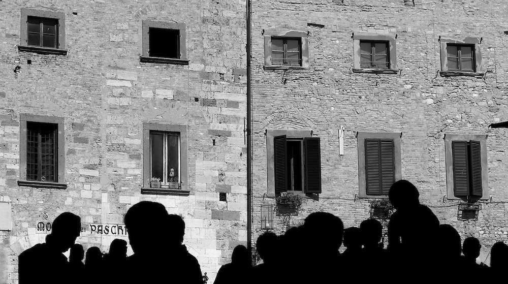 Black and white photo of a woman in window <br />
