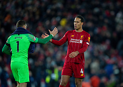 LIVERPOOL, ENGLAND - Saturday, November 30, 2019: Liverpool's Virgil van Dijk (R) and Brighton & Hove Albion's goalkeeper Mathew Ryan after the FA Premier League match between Liverpool FC and Brighton & Hove Albion FC at Anfield. (Pic by David Rawcliffe/Propaganda)