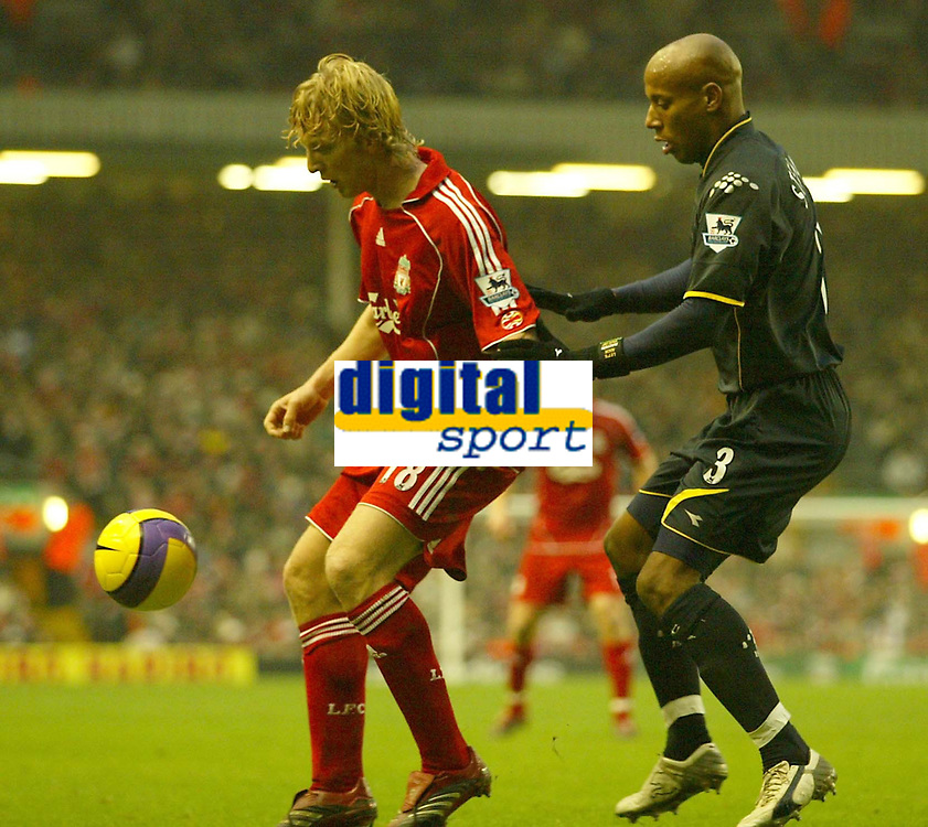 Photo: Aidan Ellis.<br /> Liverpool v Watford. The Barclays Premiership. 23/12/2006.<br /> Liverpool's Dirk Kuyt (L) is Closely watched by Watford's Jordan Stewart