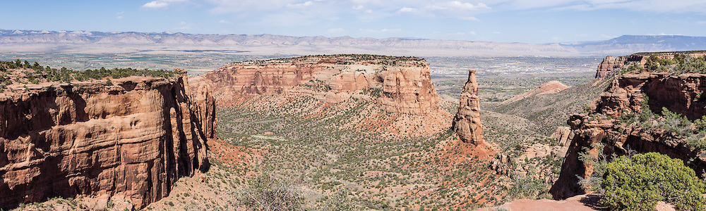 Independence Monument & Wedding Canyon, Colorado National Monument, near Grand Junction and Fruita, Colorado, USA. This desert land is high on the Colorado Plateau dotted with pinion and juniper forests. This panorama was stitched from 5 overlapping photos.