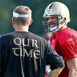 August 6, 2011; Metairie, LA, USA; New Orleans Saints quarterback Drew Brees (9) talks with head coach Sean Payton during training camp practice at the New Orleans Saints practice facility. Mandatory Credit: Derick E. Hingle
