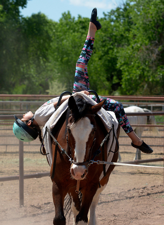 "gbs050717r/LIVING -- Esmeralda  ""Esme""  Marquez-Chavez, 9, performs a horse vaulting freestyle program during practice at Cloud Dancers of the Southwest Therapeutic Horsemanship stables. (Greg Sorber/Albuquerque Journal)"