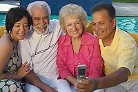 Two couples taking self portrait with mobile phone