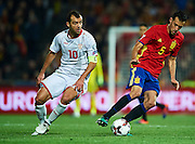 GRANADA, SPAIN - NOVEMBER 12:  Sergio Busquets of Spain (R) being followed by Goran Pandev of FYR Macedonia (L) during the FIFA 2018 World Cup Qualifier between Spain and FYR Macedonia at  on November 12, 2016 in Granada, .  (Photo by Aitor Alcalde Colomer/Getty Images)
