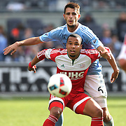 Charlie Davies, (front), New England Revolution, is challenged by Federico Bravo, NYCFC, during the New York City FC Vs New England Revolution, MSL regular season football match at Yankee Stadium, The Bronx, New York,  USA. 26th March 2016. Photo Tim Clayton