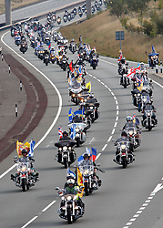© Licensed to London News Pictures. 01/10/2011, Staafordshire, UK. The fourth annual Ride to the Wall took place today (Saturday). Thousands of motorcyclists from all over the country either as individuals or in groups rode to the National Memorial Arboretum to honour and show their support for the Armed Forces. Since the first ride in 2008 the ride has raised nearly £100,000 for the NMA. .Pictured, Bikers make their way along the A5 near Weeford, Staffs on their way to the NMA..Photo credit : Dave Warren/LNP