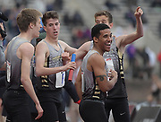 Apr 27, 2018; Philadelphia, PA, USA; Sean Dolan (second from left) celebrates with teammates Teddy Meredith, Amos Barnes Tim Dolan after running the 1,600m anchor leg on the Hopewell Valley distance medley relay that won the Championship of America race in a meet-record 9:57.55 during the 124th Penn Relays at Franklin Field.