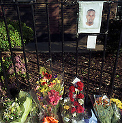 A memorial has been placed where a youth called ?Indian? died on Warner Road, Camberwell, London, England. If we drove past this place where someone's life ended, the victim would just be a statistic but flowers are left to die too with touching poems written by family and loved-ones: ?Yo Crucial/Wherever you are you are great.? From a project about makeshift shrines: Britons have long installed memorials in the landscape: Statues and monuments to war heroes, Princesses and the socially privileged. But nowadays we lay wreaths to the ordinary who die suddenly - killed as pedestrians, as drivers or by alcohol, all celebrated on our roadsides and in cities with simple, haunting roadside remembrances