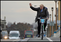 The London Mayor Boris Johnson on a Barclays Bike on the Wandsworth Bridge as he expands the Barclays Cycle Hire to Wandsworth, South West London, United Kingdom. Friday, 13th December 2013. Picture by Andrew Parsons / i-Images