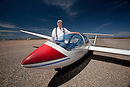 Long-time glider pilot and owner of Turf Soaring, Roy Coulliette,  poses with a Grob two-seater beside the runway at Turf Soaring in Peoria, AZ.