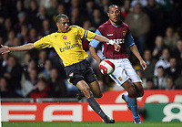Photo: Rich Eaton.<br /> <br /> Aston Villa v Arsenal. The Barclays Premiership. 14/03/2007. Gilberto left of Arsenal clears from Aston Villas John Carew