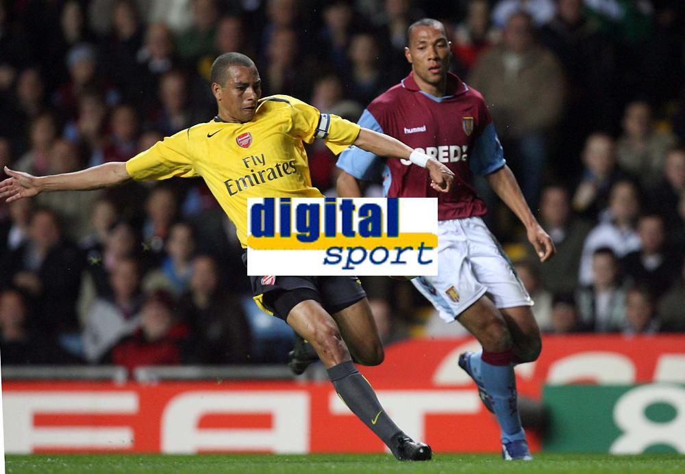Photo: Rich Eaton.<br /> <br /> Aston Villa v Arsenal. The Barclays Premiership. 14/03/2007. Gilberto left of Arsenal clears from Aston Villas John Carew