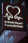 British Heart Foundation charity shop sign illuminated