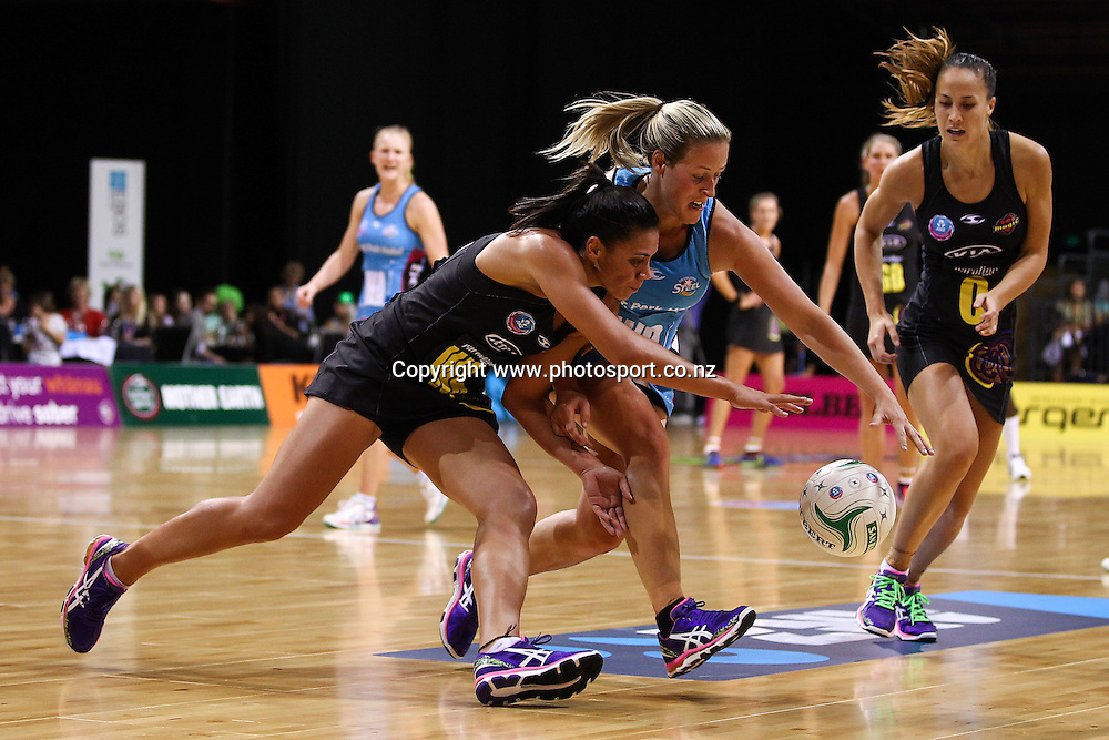 Waikato BOP Magic's Grace Rasmussen and Southern Steel's Wendy Frew chase a loose ball during the ANZ Netball Championship - Waikato BOP Magic v Southern Steel at Claudelands Arena, Hamilton on Monday 17 March 2014. Photo: Bruce Lim / www.photosport.co.nz