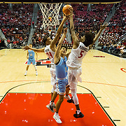 10 November 2017:  The San Diego State Aztecs men's basketball team opens up the season against San Diego Christian. San Diego State Aztecs forwards Nolan Narain (24) and Jalen McDaniels (5) block a shot by San Diego Christian Hawks forward Stephen Short (1) in the first half. The Aztecs beat the Hawks 91-52 at the half.<br /> www.sdsuaztecphotos.com