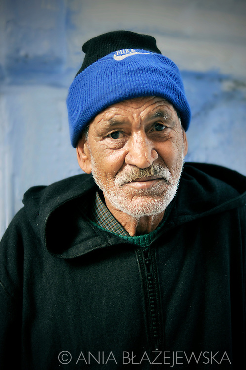 Morocco, Chefchaouen. Potrait of an older man wearing dark jellaba.