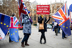 © Licensed to London News Pictures. 18/12/2018. London, UK. Anti-Brexit demonstrators wave flags in Westminster. Yesterday, Leader of the Labour Party Jeremy Corbyn tabled a motion of no confidence in British Prime Minister Theresa May, following the announcement that the postponed vote on May's EU withdrawal deal would not take place until the week beginning 14 January 2019. Photo credit : Tom Nicholson/LNP