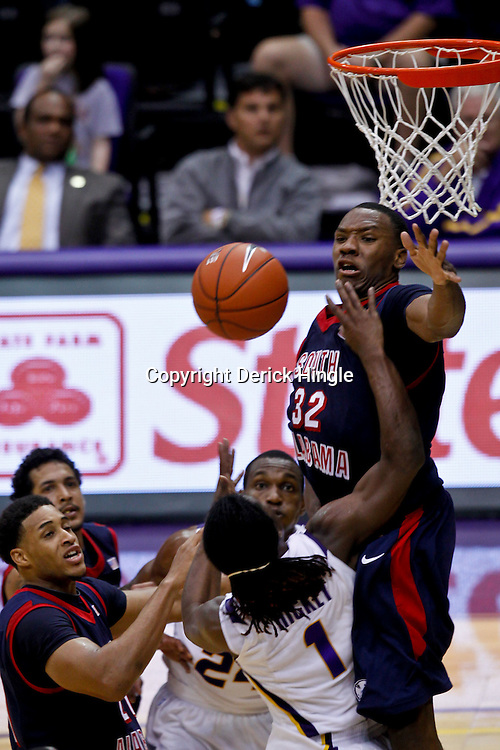 November 23, 2011; Baton Rouge, LA; South Alabama Jaguars forward Javier Carter (32) blocks a shot by LSU Tigers guard Anthony Hickey (1) during the second half of a game at the Pete Maravich Assembly Center. South Alabama defeated LSU in overtime 79-75. Mandatory Credit: Derick E. Hingle-US PRESSWIRE