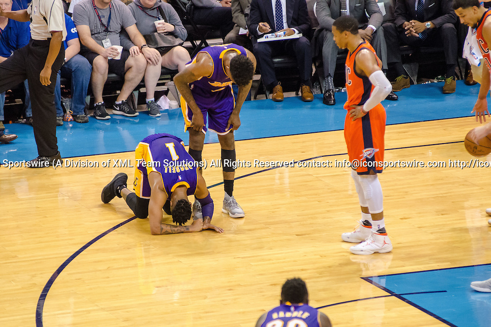 OKLAHOMA CITY, OK - OCTOBER 30:   Los Angeles Lakers Guard D'Angelo Russell (1) on his knees in pain while his teammate and Oklahoma City Thunder Guard Russell Westbrook (0) look on. October 30, 2016, at the Chesapeake Energy Arena Oklahoma City, OK. (Photo by Torrey Purvey/Icon Sportswire)