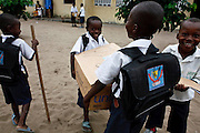Kinshasa, DRC. March 2009. School and education support provided by UNICEF. In the DRC UNICEF also helps procure supplies like school-in-a-box, a pre-packaged kit of materials like exercise books, pencils, erasers and scissors, enough for a teacher and up to 80 students.