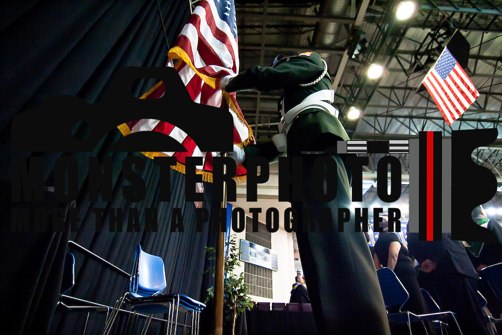 6/13/12 Newark Del: Appoquinimink Jr. R.O.T.C places the American flag on it stand during the start of commencement exercise Wednesday, June 13, 2012, at The Bob Carpenter Center in Newark Delaware...Special to The News Journal/SAQUAN STIMPSON