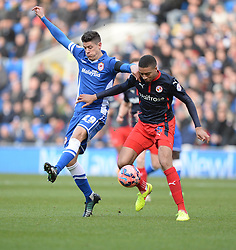 Cardiff City's Alex Revell battles for the ball with Reading's Michael Hector- Photo mandatory by-line: Alex James/JMP - Mobile: 07966 386802 - 24/01/2015 - SPORT - Football - Cardiff - Cardiff City Stadium - Cardiff City v Reading - FA Cup Fourth Round