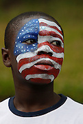 American Pride    <br /> <br /> Dorchester, MA 082711 Nathaniel Stout (Cq), 12, of Mattapan watches the Annual Caribbean Carnival and Parade on August 27, 2011 in Dorchester, MA.   (Essdras M Suarez/ Globe Staff)/MET