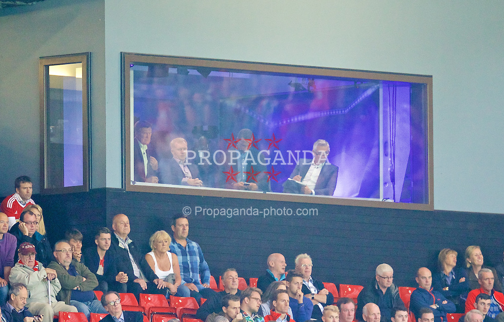MANCHESTER, ENGLAND - Tuesday, August 18, 2015: Television pundit Rio Ferdinand plays on his iPhone as colleagues Glen Hoddle, Paul Scholes and Alan Smith look on during the UEFA Champions League Play-Off Round 1st Leg match between Manchester United and Club Brugge at Old Trafford. (Pic by David Rawcliffe/Propaganda)