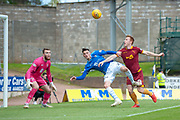 Danny Johnson (#24) of Motherwell FC looks to get to the ball ahead of Scott Tanser (#3) of St Johnstone FC, as goalkeeper Zander Clark (#1) of St Johnstone FC watches on during the Ladbrokes Scottish Premiership match between St Johnstone and Motherwell at McDiarmid Stadium, Perth, Scotland on 11 May 2019.