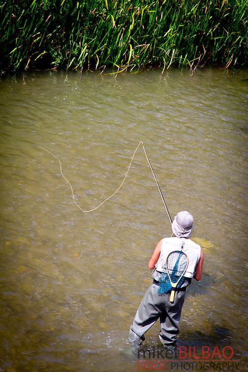 Angler in Arlanzon river.<br /> Burgos city. Castile and Leon, Spain.