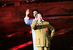 Actors playing the older and younger versions of Mao Zedong wave during 'Mao Zedong Comes from China', a show based on the former Communist leader's life in an outdoor theatre in Shaoshan, Hunan Province in central China, 27 April 2016. The show depicts Mao's life experience during the upheavals of the revolution and civil war leading to the founding of the People's Republic of China.