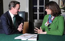 Leader of the Conservative Party David Cameron with Claire Perry.Member of Parliament for Devizes. in his office in Norman Shaw South, January 18, 2010. Photo By Andrew Parsons / i-Images.<br />