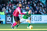 Danny Swanson (#11) of Hibernian defends against Olivier Ntcham (#21) of Celtic during the Ladbrokes Scottish Premiership match between Hibernian and Celtic at Easter Road, Edinburgh, Scotland on 10 December 2017. Photo by Craig Doyle.