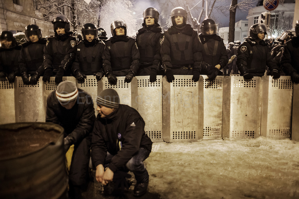A riot squad surrounds a protesters camp the police forced to evacuate near the Presidential compound, on December 9, 2013 in Kiev, Ukraine. Thousands of protesters have taken to the streets since Ukrainian president Viktor Yanukovych announced a decision to suspend a trade and partnership agreement with the European Union and raised concerns that the nation could be poised to enter a customs union with Russia.