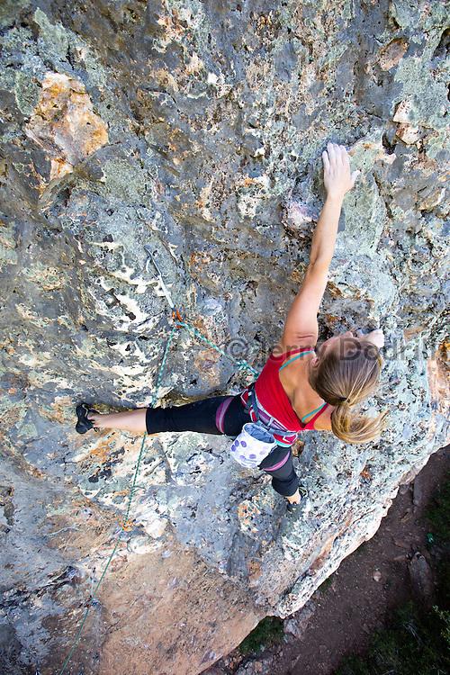 "Sarah McKay climbing ""Black hole Sun"", a 5.11d sport climb at the Bear Cliff on Mt. St. Helena in Robert Louis Stevenson State Park near Calistoga, California."