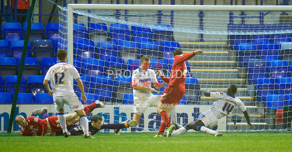 BIRKENHEAD, ENGLAND - Friday, November 16, 2012: Milton Keynes Dons's Stephen Gleeson scores the winning goal against Tranmere Rovers during the Football League One match at Prenton Park. (Pic by David Rawcliffe/Propaganda)
