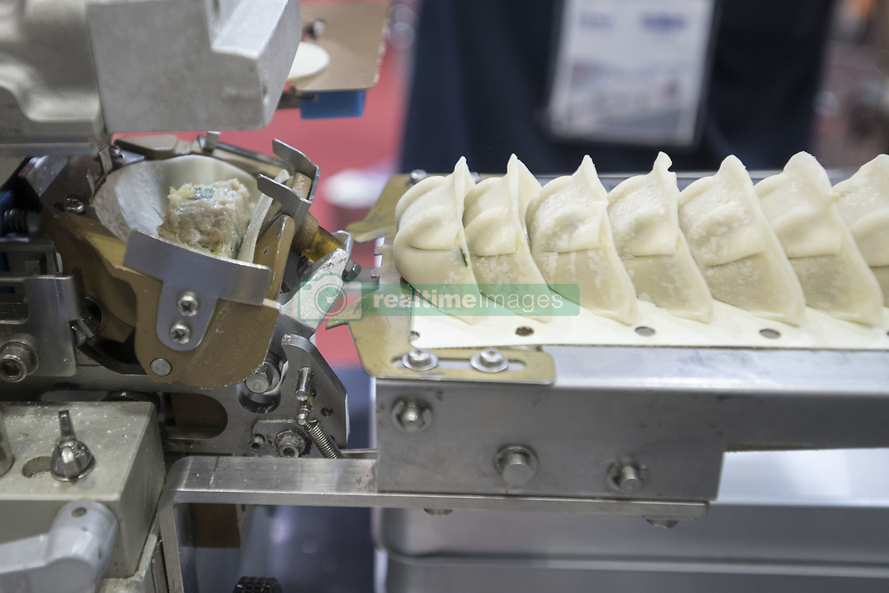 June 15, 2018 - Tokyo, Tokyo, Japan - Toa Industry Co., Ltd.: Fully-automated gyoza-making machine on display at the International Food Machinery & Technology Exhibition ''FOOMA JAPAN'' 2018 in Tokyo Big Sight on June 15, 2018, Tokyo, Japan. FOOMA JAPAN showcases the latest products and services for food processing in 6 halls of the exhibition center. The show is organized by the association of 53 food related industries. (Credit Image: © Alessandro Di Ciommo/NurPhoto via ZUMA Press)