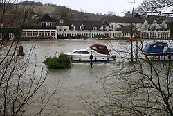 The world famous Swan hotel at Goring on Thames, Oxfordshire, puts sandbags on the terrace next to the river, United Kingdom, Tuesday, 11th February 2014. Picture by i-Images