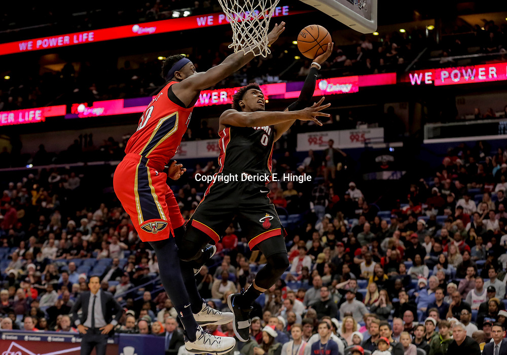 Dec 16, 2018; New Orleans, LA, USA; Miami Heat guard Josh Richardson (0) shoots over New Orleans Pelicans forward Julius Randle (30) during the first half at the Smoothie King Center. Mandatory Credit: Derick E. Hingle-USA TODAY Sports