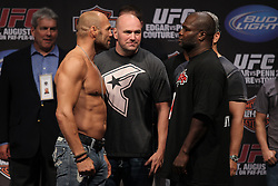August 27, 2010; Boston, MA; USA; Randy Couture and James Toney face off around UFC president Dana White after weighing in for their upcoming bout at UFC 118.
